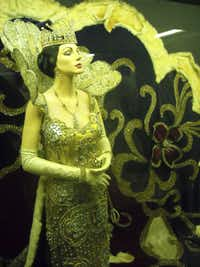 Germaine Cazenave Wells, shown in mannequin form in a Mardi Gras costumes, haunts Arnaud's Restaurant in the French Quarter, according to many who've seen her. A second-floor exhibit shows costumes she owned. Mannequins' faces look like the late Mrs. Wells, daughter of ex-owner Arnaud Cazenave.