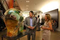 Art aficionados admire the work of Oleg Dou, left, and Olga Tobreluts, right, at a pre-party to kick off the Dallas Art Fair, on April 12, 2012 at the Fashion Industry Gallery in Downtown Dallas. The piece work is selling for 85, 000. Ben Torres/Special Contributor