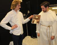"Designer Austin Scarlett (left) shows Ian McEuen a painting that provided Scarlett's inspiration for McEuen's costume. McEuen will play Padre in the world-premiere production of ""With Blood, With Ink,"" in April 2014 for the Fort Worth Opera.(Joy Tipping/Staff)"