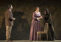 "Nathan Gunn, left, in the role of The Lodger, Susan Graham, in the role of Tina and Alexandra Deshorties in the role of Juliana Bordereau perform a scene from Dominick Argento's opera ""The Aspern Papers"" during a dress rehearsal at The Margot and Bill Winspear Opera House at the AT&T Performing Arts Center on Thursday evening April 5, 2013 in Dallas, Texas."