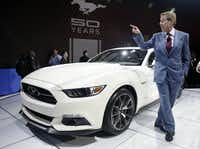 Ford Motor Company CEO and President Bill Ford stands beside a 2015 Ford Mustang 50 Year Limited Edition during its introduction at the 2014 New York International Auto Show at the Javits Convention Center, Wednesday, April 16, 2014, in New York.  (AP Photo/Richard Drew)(Richard Drew - AP)