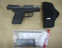 This Feb. 27, 2012, photo released by the State Attorney's Office shows the Kel-Tec PF-9 9mm handgun used by George Zimmerman, the neighborhood watch volunteer who shot Trayvon Martin. The photo was among evidence released by prosecutors that also includes calls to police, video and numerous other documents. The package was received by defense lawyers earlier this week and released to the media on Thursday.(State of Florida Attorney's Office)