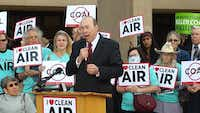 Dr. Robert Haley of Dallas speaks at a news conference outside an Arlington hearing on an EPA proposal to strengthen the national standard on ozone. (File Photo/Staff)