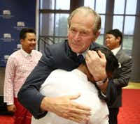 Former President George W. Bush greets Chit Min Lay following the graduation ceremony of the Liberty and Leadership Forum's 2016 Class of Young Leaders from Burma. (Andy Jacobsohn/The Dallas Morning News)