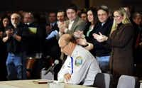 Chief of Police Michael Kehoe receives a standing ovation from families of victims of the Sandy Hook Elementary School shooting, during a 2013 hearing on gun violence and children's safety in Newtown, Conn. (AP Photo/Jessica Hill)