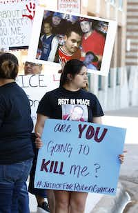Rheana Rangel held a sign with a phrase uttered by Rubén García Villalpando before he was shot by a Grapevine police officer. (MARK ROGERS/Special Contributor)