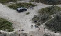 Members of the Texas National Guard patrol along the Rio Grande at the Texas-Mexico border in Rio Grande City in December. (AP Photo/Eric Gay, File)