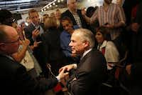 """Texas Gov. Greg Abbott (center) shakes hands with State Rep. Kenneth Sheets, R-Dallas, at Pecan Lodge in Dallas last week during a multi-city """"grassroots tour. """"(G.J. McCarthy/The Dallas Morning News)"""