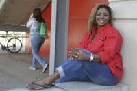 "Roni Dean-Burren poses on the campus of the University of Houston, in Houston. Dean-Burren asked publisher McGraw-Hill Education to change the text in a geography book that refers to slaves as ""workers."" Texas may vote this week on having outside experts check textbooks used in its public school classrooms for factual errors. (AP File Photo/Pat Sullivan, File)"