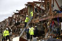 Firefighters looks for survivors trapped in an apartment destroyed when a fertilizer storage faciltyexploded Wednesday in West, Texas..LM Otero - Staff Photographer