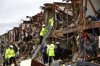 Firefighters looks for survivors trapped in an apartment destroyed when a fertilizer storage faciltyexploded Wednesday in West, Texas..(LM Otero - Staff Photographer)