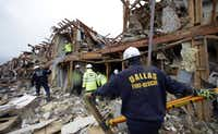 A Dallas firefighter looks for survivors trapped in an apartment destroyed when a fertilizer storage faciltyexploded Wednesday in West, Texas.LM Otero - AP