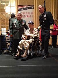 Al Zapanta of Irving (left) and Admiral Patrick Walsh (right) present the 2013 Allies of Freedom Award European Theatre to Sgt. Robert Bearden at the Daughters of WW II luncheon on Veterans Day.( Staff photo by DEBORAH FLECK )