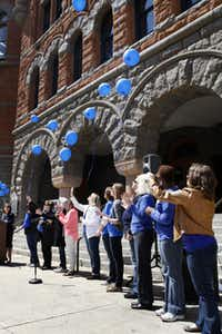 Eleven balloons are released in front of the Old Red Courthouse in memory of 11 children that died in 2012 in Dallas County because of child abuse.