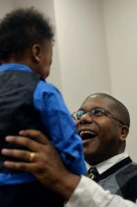 Jeffrey Coleman, right, smiles at his newly adopted son Lawrence Coleman, 2, both of Lewisville, Texas, during National Adoption Day at the Henry Wade Juvenile Justice Center in Dallas on Saturday Nov. 21, 2015. (Rachel Woolf/The Dallas Morning News)