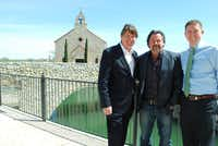 Jeff Blackard, George Fuller and Michael Quint stand outside the Bella Donna chapel, one of iconic areas of Adriatica Village.