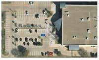 Flower Mound Police Department recently added two designated parking spaces for online transactions. This aerial graphic has two blue arrows pointing to where the spots are in relation to the building.( Photo submitted by MOLLY FOX )
