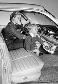 Wanda and Darrin Mitchell show off a 1960 under-dash air-conditioning unit by Frigikar.( Dallas Public Library )