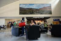 "Artist Dennis Blagg's painting, ""Cosmic Big Bend,"" hangs above a Starbucks at Dallas/Fort Worth International Airport on May 6, 2014. The airport houses an art collection worth more than an estimated $8 million, that includes four sculptures on loan from the Nasher Sculpture Center. Tours of the art collection are given upon request. (Rose Baca/Neighborsgo Staff Photographer)( Rose Baca  -  neighborsgo staff photographer )"