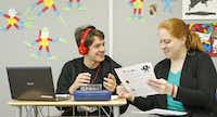 Eighth-grader Jonathan Brady, 13 (left), discusses a classroom exercise with teacher Meghan Coleman during an algebra class. Alcuin School previously only offered classes up to eighth grade.(Jim Tuttle - Staff Photographer)
