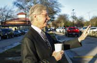 Head of School Walter Sorenson waves as parents arrive with their children for the morning at Alcuin School in Dallas. The private school is seeking a rezoning, which would allow it to add 100 more students in 10th through 12th grades. Residents in the Forest Hills Neighborhood Association are opposed to the request, saying it would increase traffic along an already narrow street.( Staff photo by JIM TUTTLE   -  DMN )