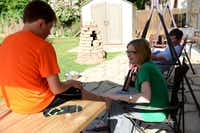 Allyson Hendrickson talks to her son, Cade, in the family's backyard in Flower Mound.(Photo by ROSE BACA - neighborsgo staff photographer)