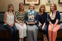 Allyson Hendrickson middle) with Ally's Wish board members (from left) Melissa Phipps, Heather Bryan, Melissa Cary and Holly Reed. For seven years, Hendrickson, who is in hospice care, has kept a blog detailing her experience with ovarian cancer and thoughts about her three boys. She is also the first recipient for Ally's Wish, a fledgling foundation in her honor dedicated to granting the wishes of mothers with terminal illnesses.(Photo by ROSE BACA - neighborsgo staff photographer)