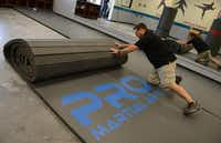 Matthew Woody rolls out the mat in his new Pro Martial Arts gym in Frisco. The gym will offer a 12-week bullying prevention program, named Armor, developed for children ages 3 and older. For more information on the program or the gym, call 469-362-4300 or visit promartialarts.com/frisco.Rose Baca - neighborsgo staff photographer