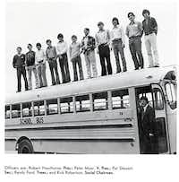 Officers of Lake Highlands High School's 1973 Exchange Club  line up along the top of a bus for a group shot.Submitted photo