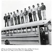 Officers of Lake Highlands High School's 1973 Exchange Club  line up along the top of a bus for a group shot.( Submitted photo )