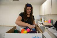 Stephanie McPherson, Shugart Elementary School's new art teacher, unpacks supplies in the school's new art room. The Garland ISD board of trustees approved a plan to expand its art program to include 47 elementary schools in the next five years.Photo by ROSE BACA  -  neighborsgo staff photographer