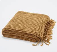Wrap it up For crisp autumn days, a cozy Shaker-knit throw with twisted fringe in seasonal harvest gold is just the thing for arm chair snuggling. Austin throw, 50- by 60-inches, $59 at Pottery Barn (multiple locations) and potterybarn.com