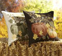 Autumn crewel An embroidered pumpkin and vine design adorns 20-inch-square pillow covers of ivory or brown cotton with button closure. Down blend or synthetic pillow inserts are sold separately. Pillow cover $59.50 and inserts $18 at Pottery Barn (multiple locations) and pottterybarn.com