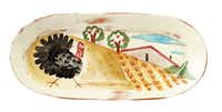 Taste of Tuscany The ambience of the Italian countryside is recreated on a hand-painted, 16-inch long, terra cotta platter featuring warm colors and a plucky turkey. $99 at Nicholson-Hardie Garden & Nursery, Dallas, and vietri.com
