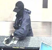 The Mesh Mask Bandit is shown robbing a Chase Bank in West Plano.