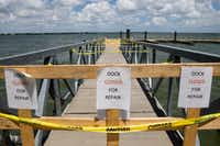 Harbor Point boat dock is closed off because of damage. (Ting Shen/The Dallas Morning News)