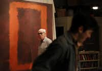 """Kieran Connolly (background), as Mark Rothko, and Jordan Brodess, as Ken, rehearse the Dallas Theater Center production of """"Red,"""" which runs through March 24, at the Wyly Theatre."""