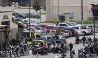 Authorities investigate a mass shooting at the Twin Peaks restaurant in Waco, Texas on May 18, 2015. A fight between rival biker gangs broke out in the bathroom of the Twin Peaks and erupted in a shootout leaving nine dead and 18 others wounded. (Rose Baca/The Dallas Morning News) 05202015xBRIEFING