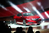 The 2015 Acura TLX is a muscular pre-production version of its midsize TLX sedan, which will slot in between the compact ILX and larger TLX sedans.