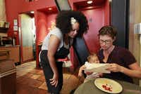 Caffe 817's Emily Goldenberg (right), with employee Shuana Nichols, had to raise menu prices slightly but still backs the change.(Laura A. Oda - Bay Area News Group)