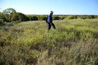 John Lingenfelder, with the Native Plant Society of Texas's Collin County Chapter, said he's no longer concerned for the prairie's future. By the end of the year, the city plans to install a split rail fence around six acres of the park's most defined prairie land.( ROSE BACA )