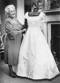 Kay, shown  in a 1981 photo, used a dress form in crafting specialty dresses at her home in Raleigh.(John Rottet - The News & Observer)