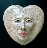 """Heart Lines,"" ceramic raku mask by Louise Murdock, part of the ""El Corazon"" (accent on the second o) exhibit at the Bath House Cultural Center, Feb. 1-March 1, 2014."