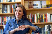 "FILE - In this Friday, May 16, 2008, file photo, author Louise Erdrich reflects on growing up in North Dakota and her new book ""The Plague of Doves"" at her store BirchBark Books in Minneapolis. Louise Erdrich is more than this year's winner of the National Book Award for fiction. She's a bookstore owner and has some ideas for what customers might pick up as holiday gifts."
