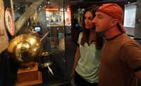 Glenda Smith of Fort Worth and Chris Hayward of Boston check out items documenting women's history in bowling, at the International Bowling Museum & Hall of Fame.( Brad Loper  -  Staff Photographer )