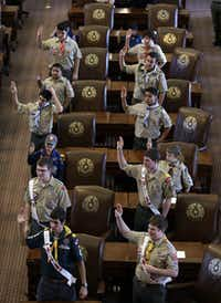Boy Scouts recite the Scout Oath during the annual Boy Scouts Parade and Report to State in the House Chambers at the Texas capitol, Saturday, Feb. 2, 2013, in Austin, Texas. Gov. Rick Perry said emphatically Saturday that the Boy Scouts of America shouldn't soften its strict no-gays membership policy, and suggested that bending the organization to the whims of popular culture is wrong.(AP Photo/Eric Gay)(Eric Gay - AP)