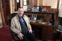 In this March 24, 2014 photo Jim Haertel sits at the desk of Frederick Pabst, who started the Pabst Brewery in 1884, in Milwaukee. He bought the company's former administrative building and another one in 2001. He supports an effort to try to raise money to bring the company's headquarters back to Milwaukee.  (AP Photo/Carrie Antlfinger)Carrie Antlfinger - AP