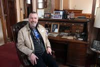 In this March 24, 2014 photo Jim Haertel sits at the desk of Frederick Pabst, who started the Pabst Brewery in 1884, in Milwaukee. He bought the company's former administrative building and another one in 2001. He supports an effort to try to raise money to bring the company's headquarters back to Milwaukee.  (AP Photo/Carrie Antlfinger)(Carrie Antlfinger - AP)