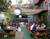 At the New York Loft Hostel, residents and visitors mingle on the patio, also the site of summer barbecues. Bushwick's loft buildings house both businesses and apartments.( Special Contributor  -  Louise Hudson  )