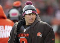 In this Sunday, Oct. 18, 2015, photo Cleveland Browns quarterback Johnny Manziel watches on the sidelines during the second half of an NFL football game against the Denver Broncos, in Cleveland. Police have released a dash-cam video and 9-1-1 emergency calls from a roadside incident involving Manziel. The former Heisman Trophy winner was questioned by Avon, Ohio, police last week after Manziel got into an argument with his then-girlfriend, Colleen Crowley. (AP Photo/Aaron Josefczyk)